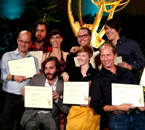 Part of the Regular Show Crew holding their Emmy Nomination Certificates.